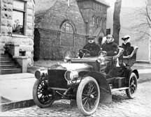 Mr. and Mrs. George L. Hartford in touring car c.1920